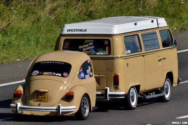 vw bus with half-beetle trailer